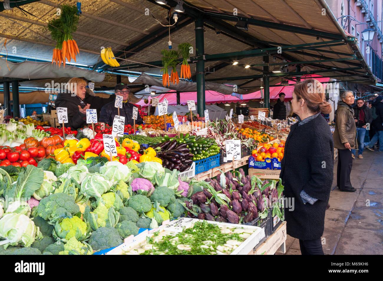 Venetian woman shopping at the Rialto Vegetable Market,  Rialto Mercato, San Polo, Venice, Veneto, Italy - Stock Image