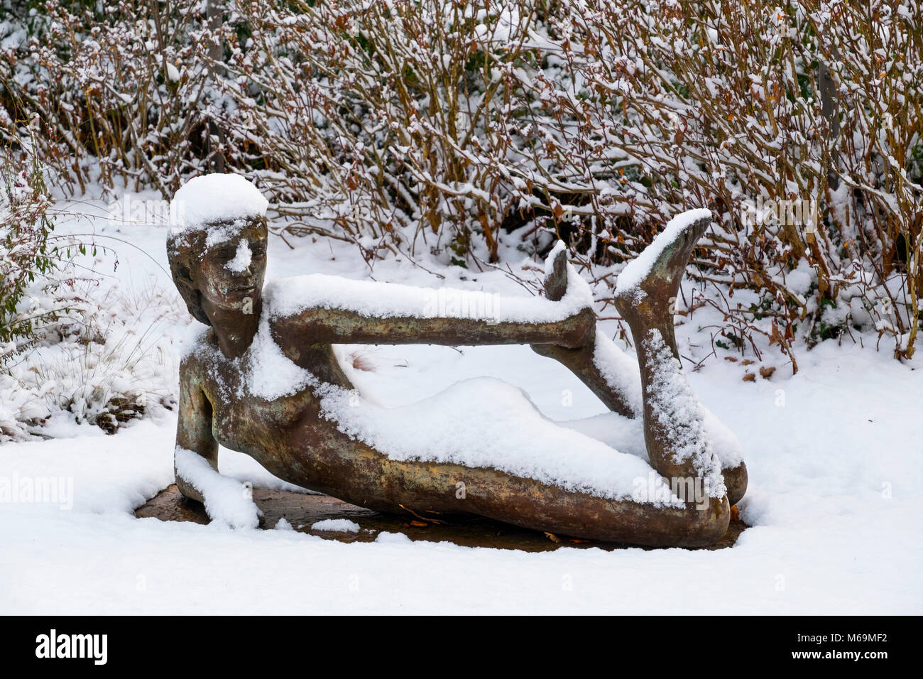 Snow scene. Sculpture in the town hall park, Troinex, Tomorrow I go to the printing press, how many copies of the book Climate Change do you want? Stock Photo
