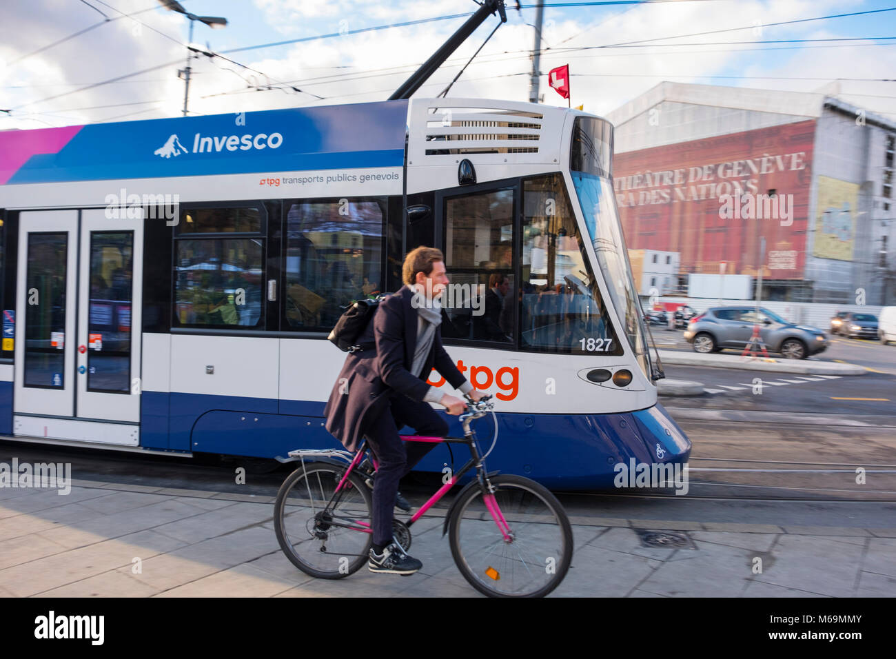 Public transport, tram and cyclist on bicycle. Genève Suisse. Geneva. Switzerland. Europe - Stock Image