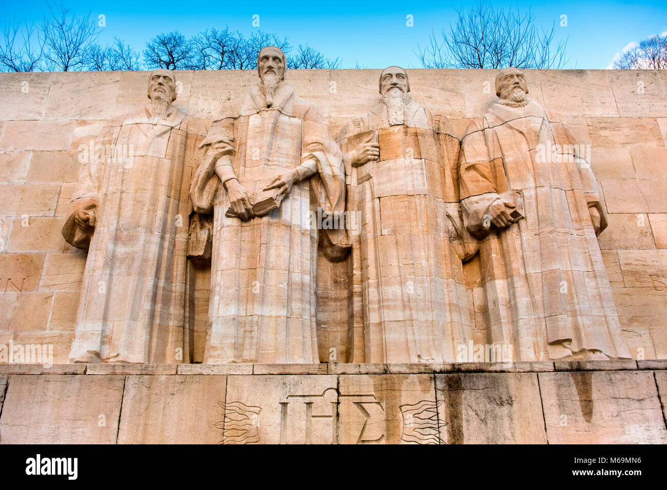 Reformation Wall Bastions Park. Guillaume Farel, Jean Calvin, Theodore de Bèze and John Knox, historic center. - Stock Image