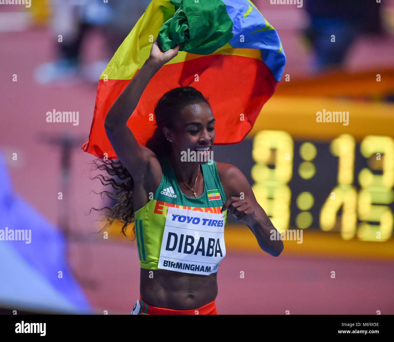 Birmingham, UK. 1st March, 2018. Genzebe Dibaba (ETH) celebrates winning of the gold medal for the Women's 3000m - Stock Image
