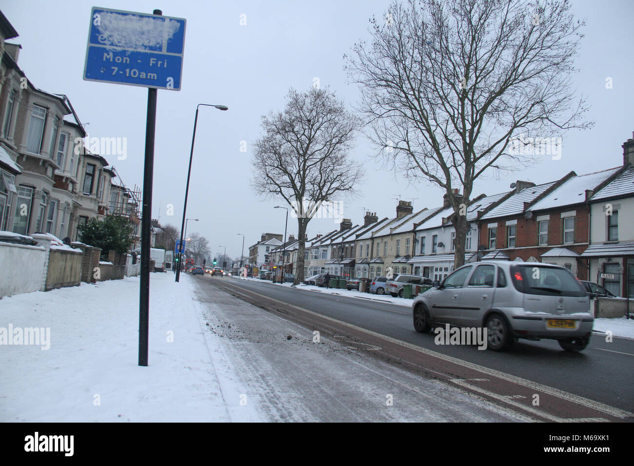 London, UK. 1st Mar, 2018. Romford Road partly covered with snow after  heavy overnight snowfall as Storm Emma and - Stock Image