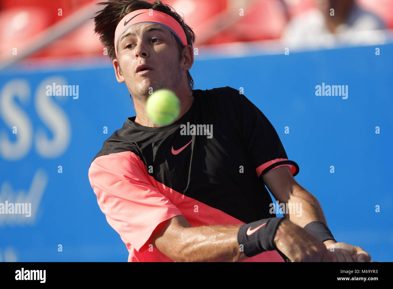 US tennis player Jared Donaldson in action against Spanish Feliciano Lopez during their Mexico Tennis Open quarter - Stock Image