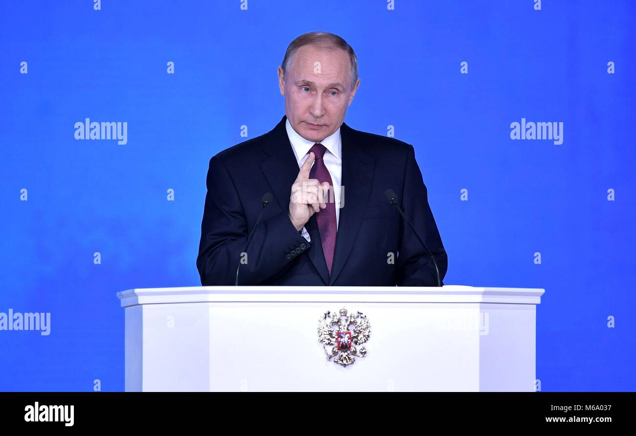Russian President Vladimir Putin delivers the annual address to the Federal Assembly televised live to the nation - Stock Image