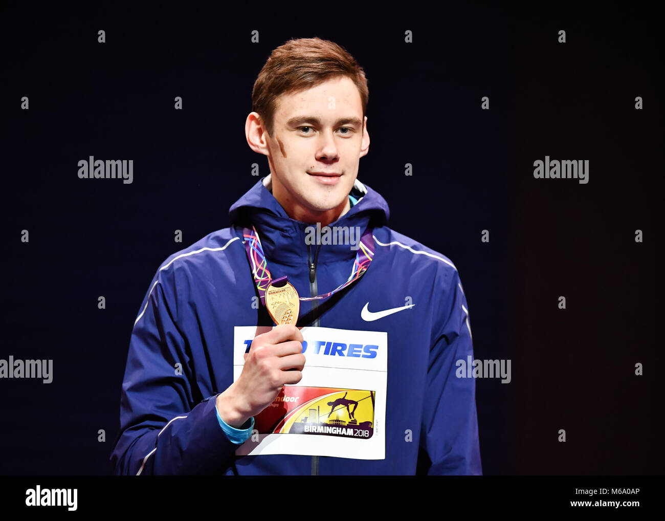 Birmingham, UK. 1st March, 2018. Nanil Lysenko shows his goal medal at the Winner's Presentation during IAAF - Stock Image