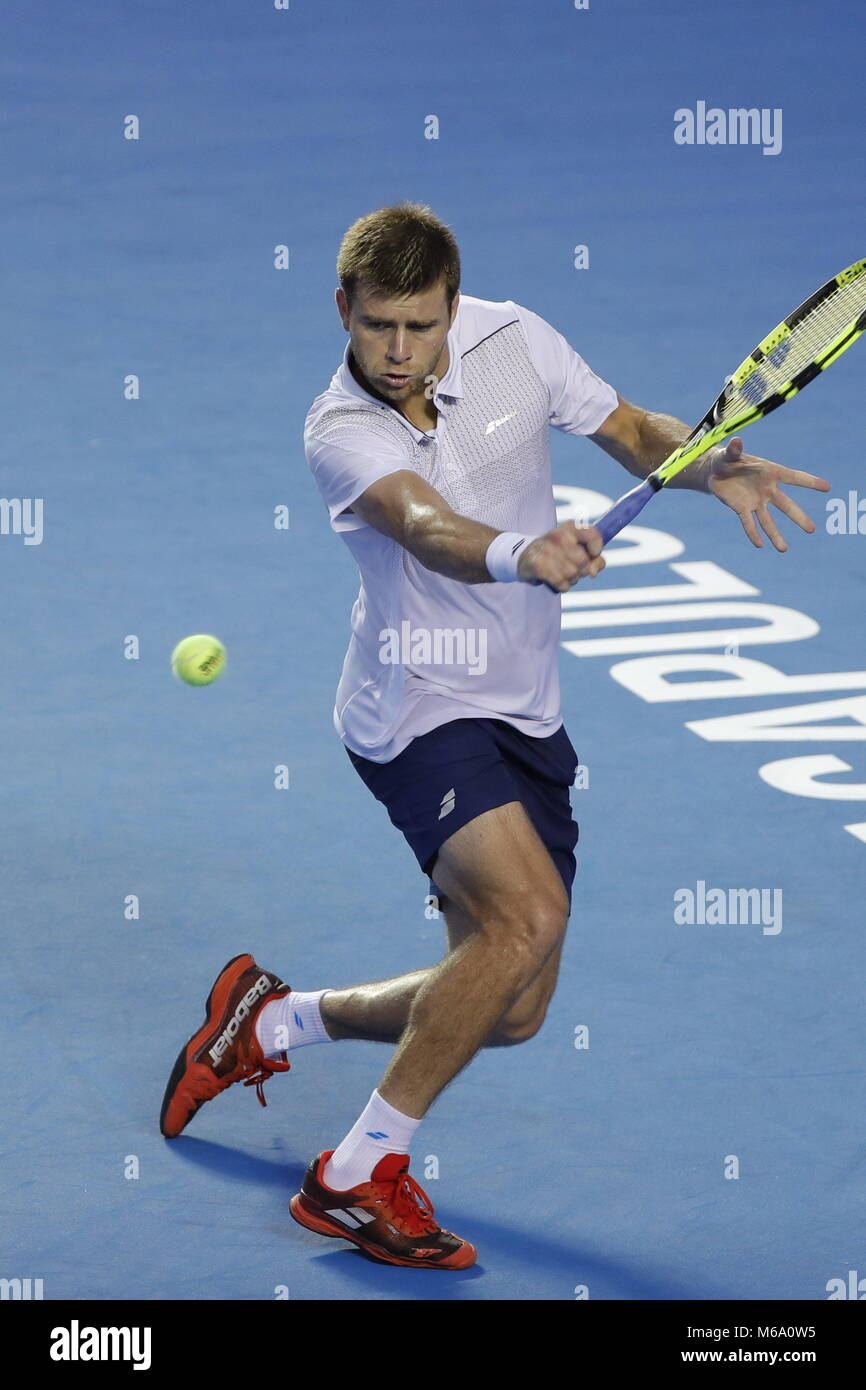 US tennis player Ryan Harrison in action against Alexander Zverev of Germany during their Mexico Tennis Open quater - Stock Image