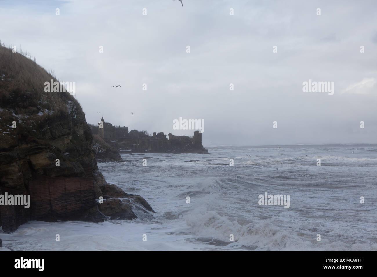 St. Andrews coastline. 1st Mar, 2018. UK Weather: Strong waves batter the coastline of East Sands, St. Andrews, - Stock Image