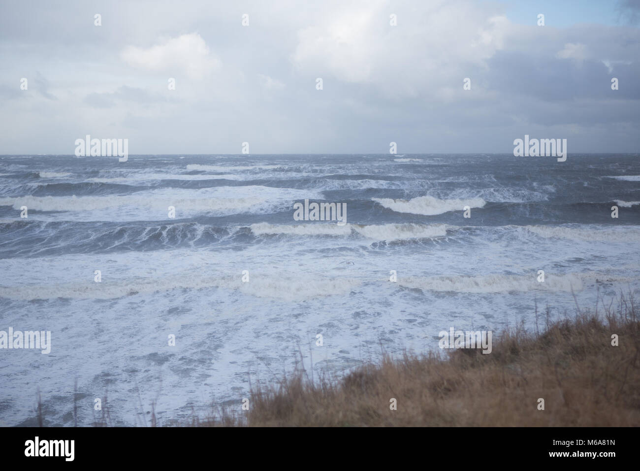 St. Andrews coastline. 1st Mar, 2018. UK Weather: Strong waves batter the coastline of East Sands, St. Andrews during - Stock Image