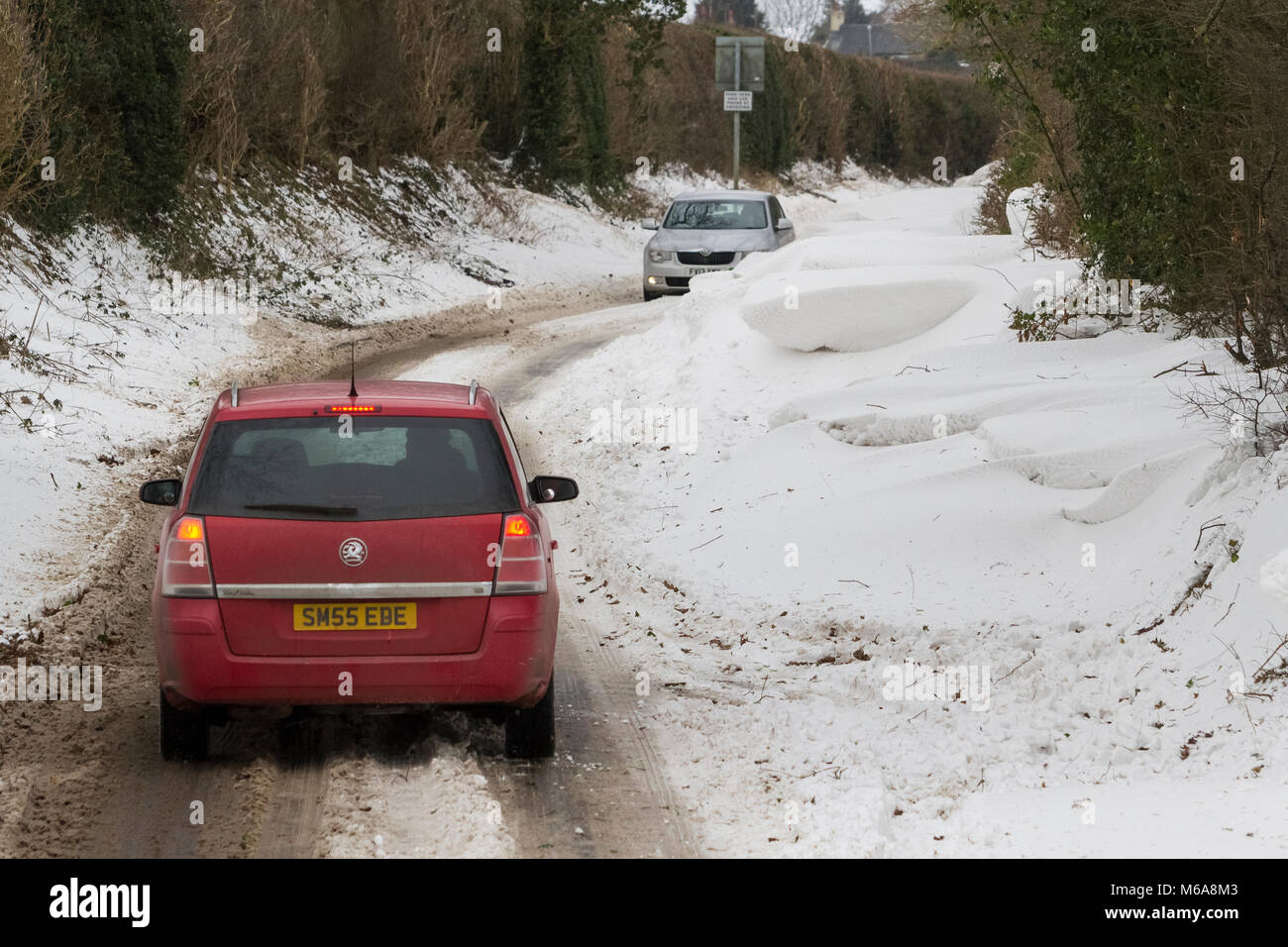 Uttoxeter, Staffordshire, UK. 02nd Mar, 2018. UK Weather: cars stranded in huge snow drifts near Uttoxeter, due - Stock Image