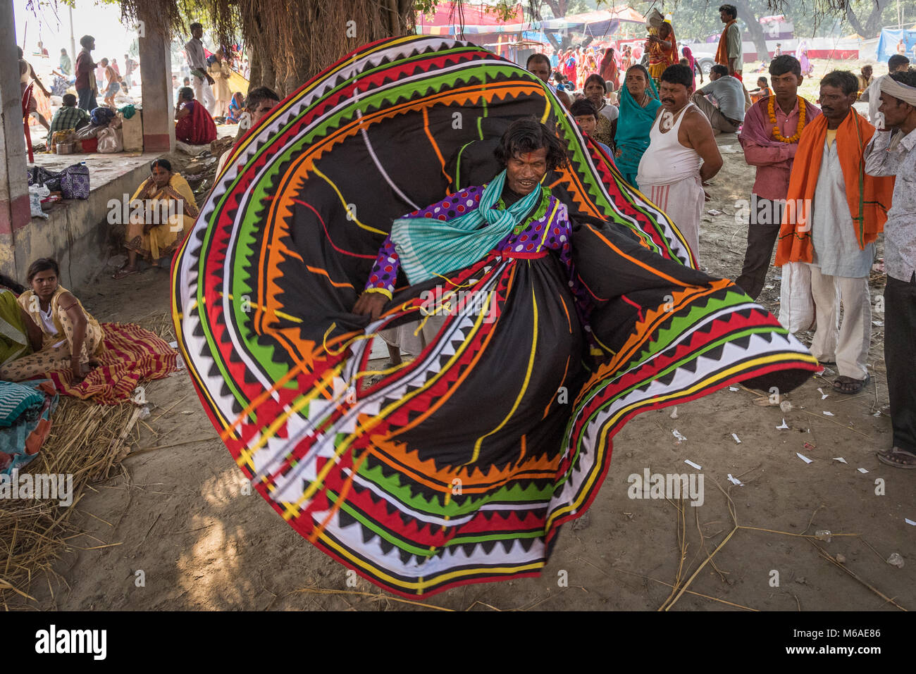 A man dancing and twirling about just before the Kartika Purnima (Deva-Diwali) festival in Sonepur, India. - Stock Image