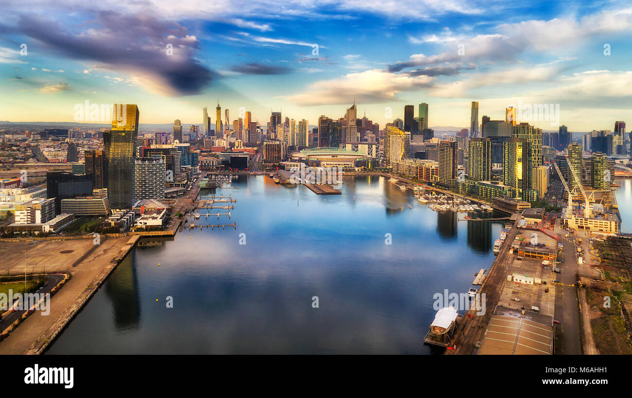 Yarra river surrounded by Melbourne suburb Docklands in elevated aerial view facing city CBD waterfront and towers - Stock Image
