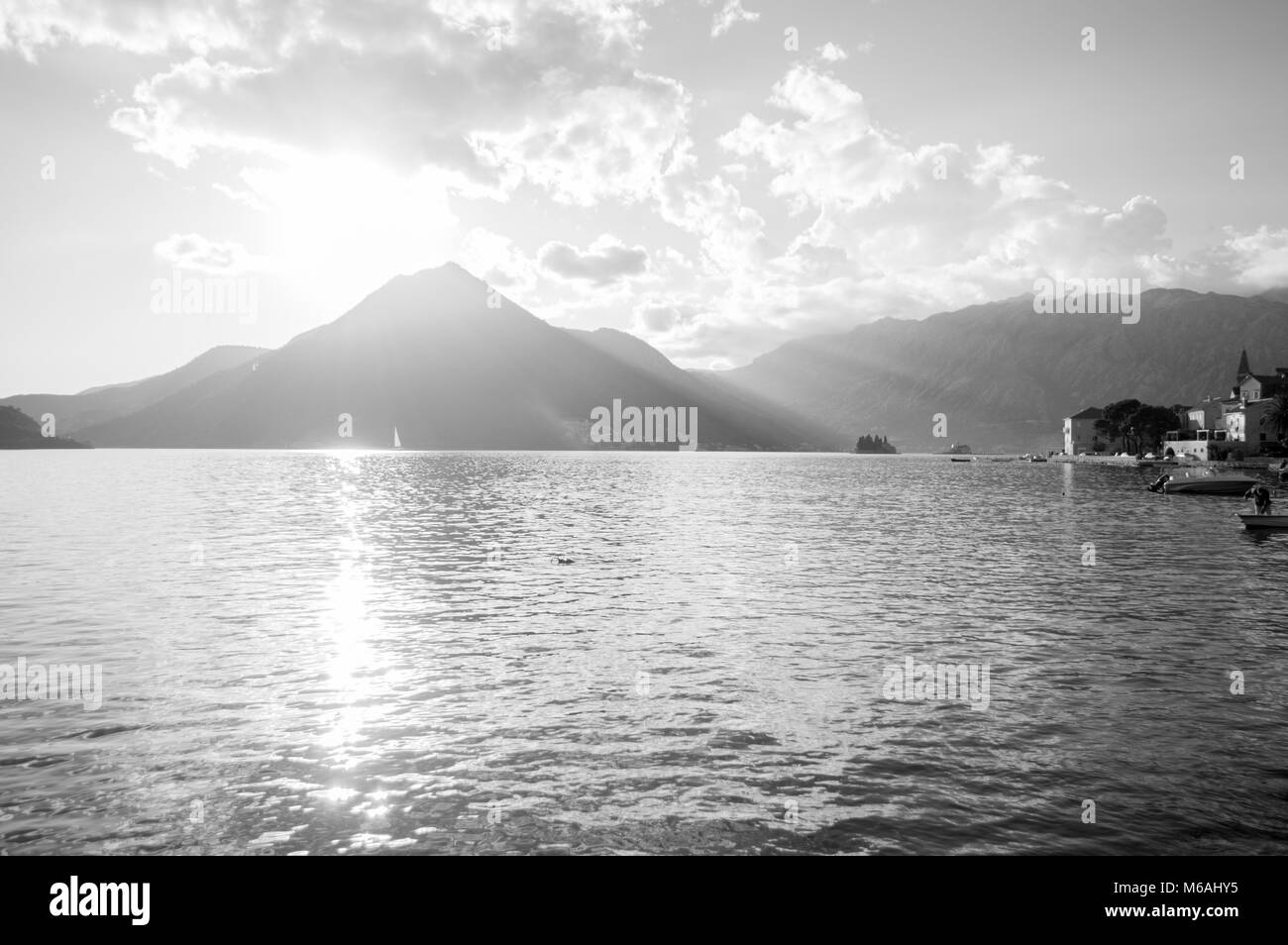 Different Perspective on Perast with Fisherman, Bay of Kotor, Montenegro - Stock Image