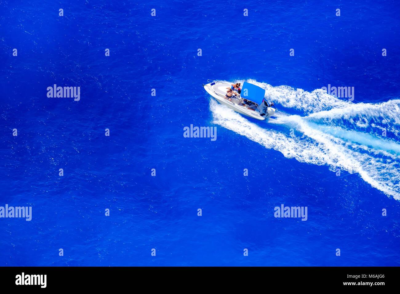 Speed boat sailing along the coast in Zakynthos, Greece - Stock Image