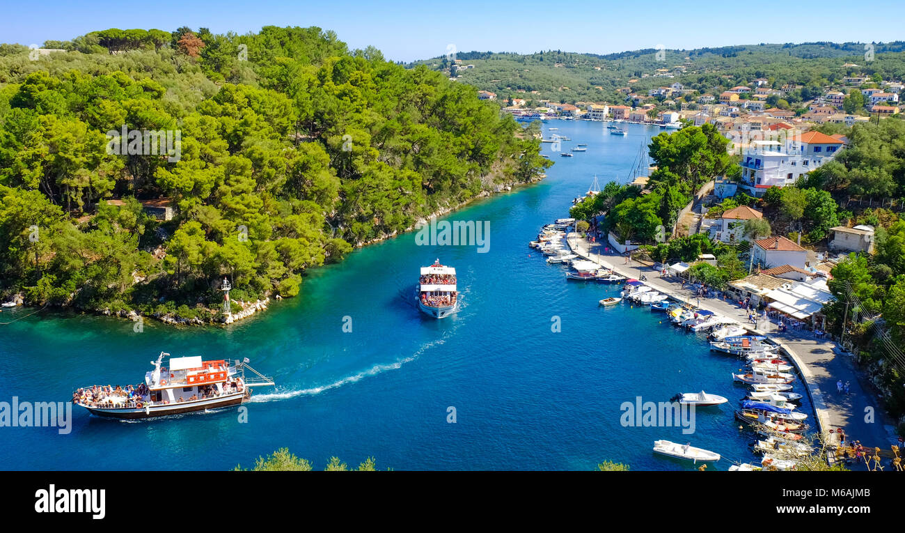 Paxos island panorama with boat entering the grand canal - Stock Image