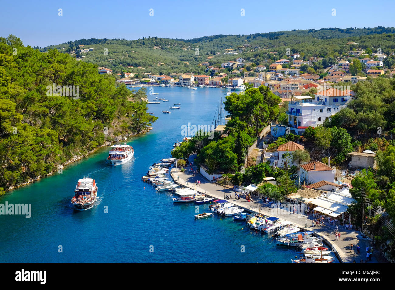 Paxos island with boat entering the grand canal - Stock Image