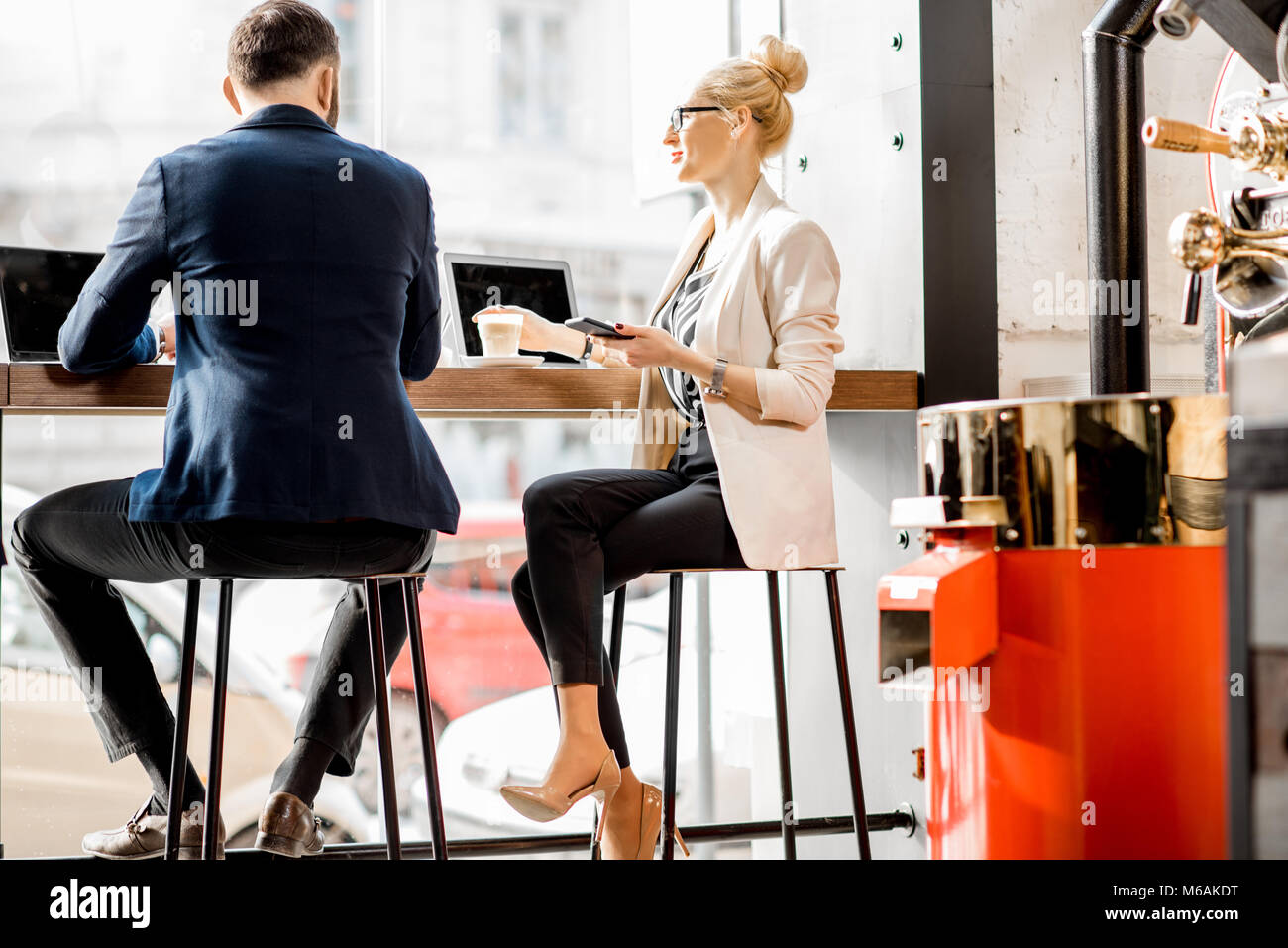 Business couple in the cafe - Stock Image