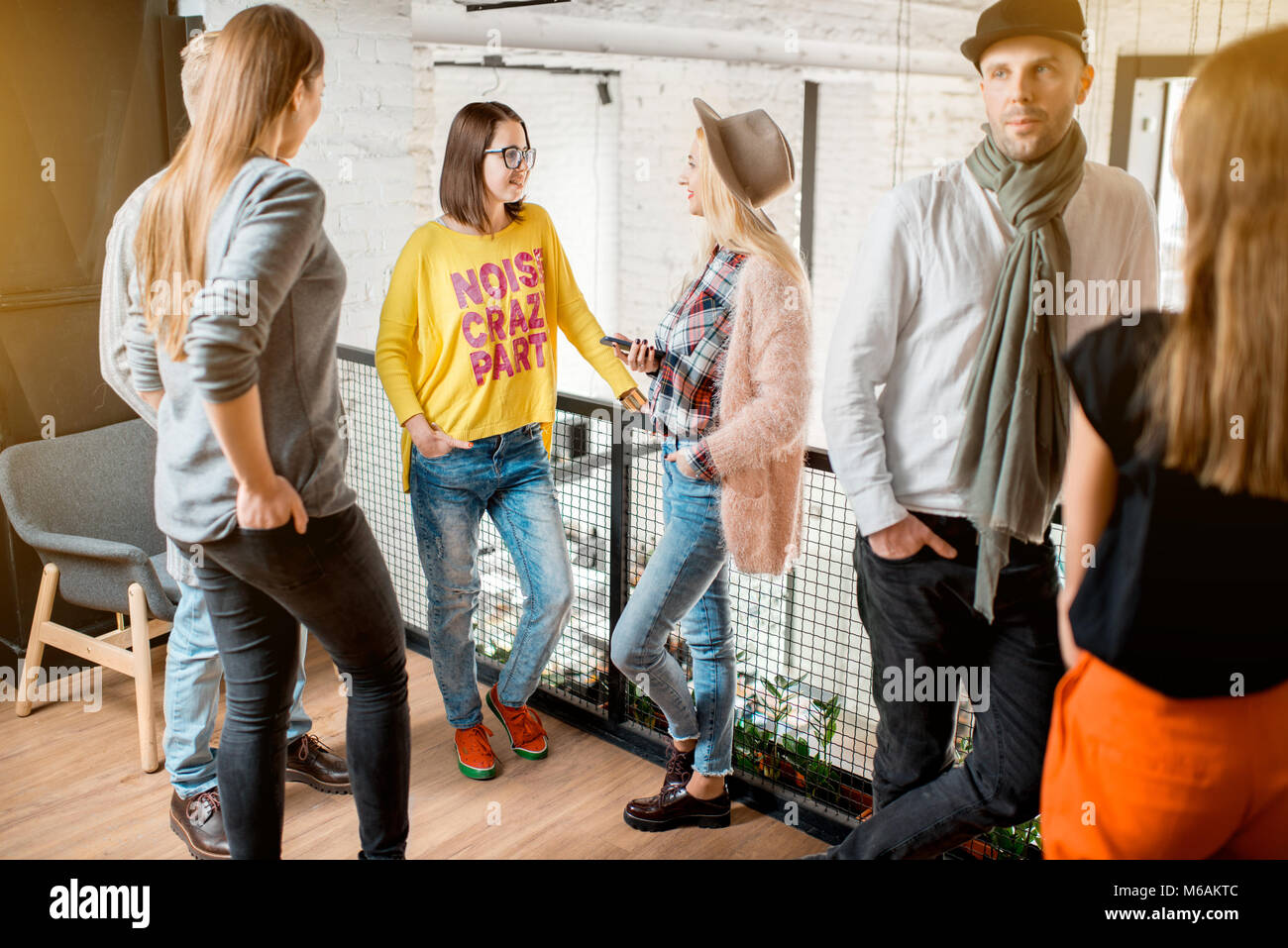 Friends talking during the break in the conference hall - Stock Image