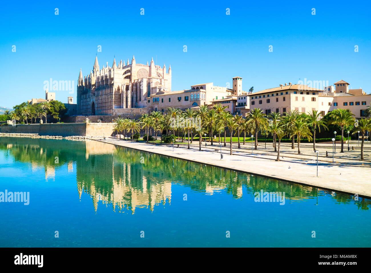 La Seu - the famous medieval gothic catholic cathedral. Palma de Mallorca, Spain. Water reflection. - Stock Image