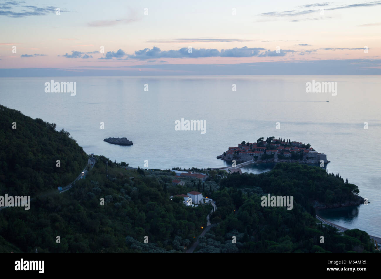 Different Panoramic Angle onto Sveti Stefan Island seen from Lookout Point during Sunset, Montenegro - Stock Image