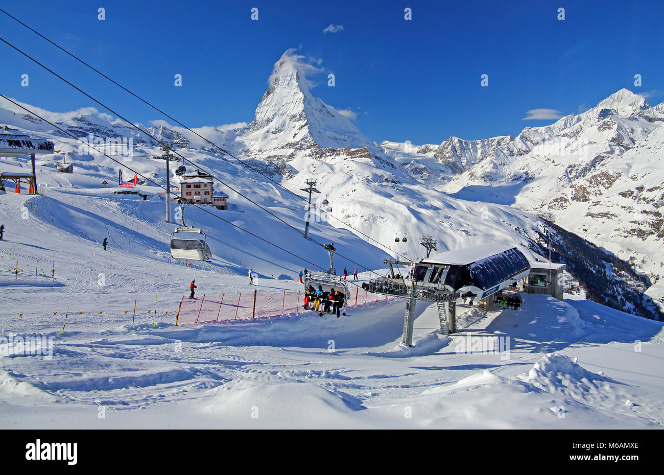 Ski area Riffelberg with chairlift, in the back Matterhorn 4478m, Zermatt, Mattertal, Valais, Switzerland - Stock Image