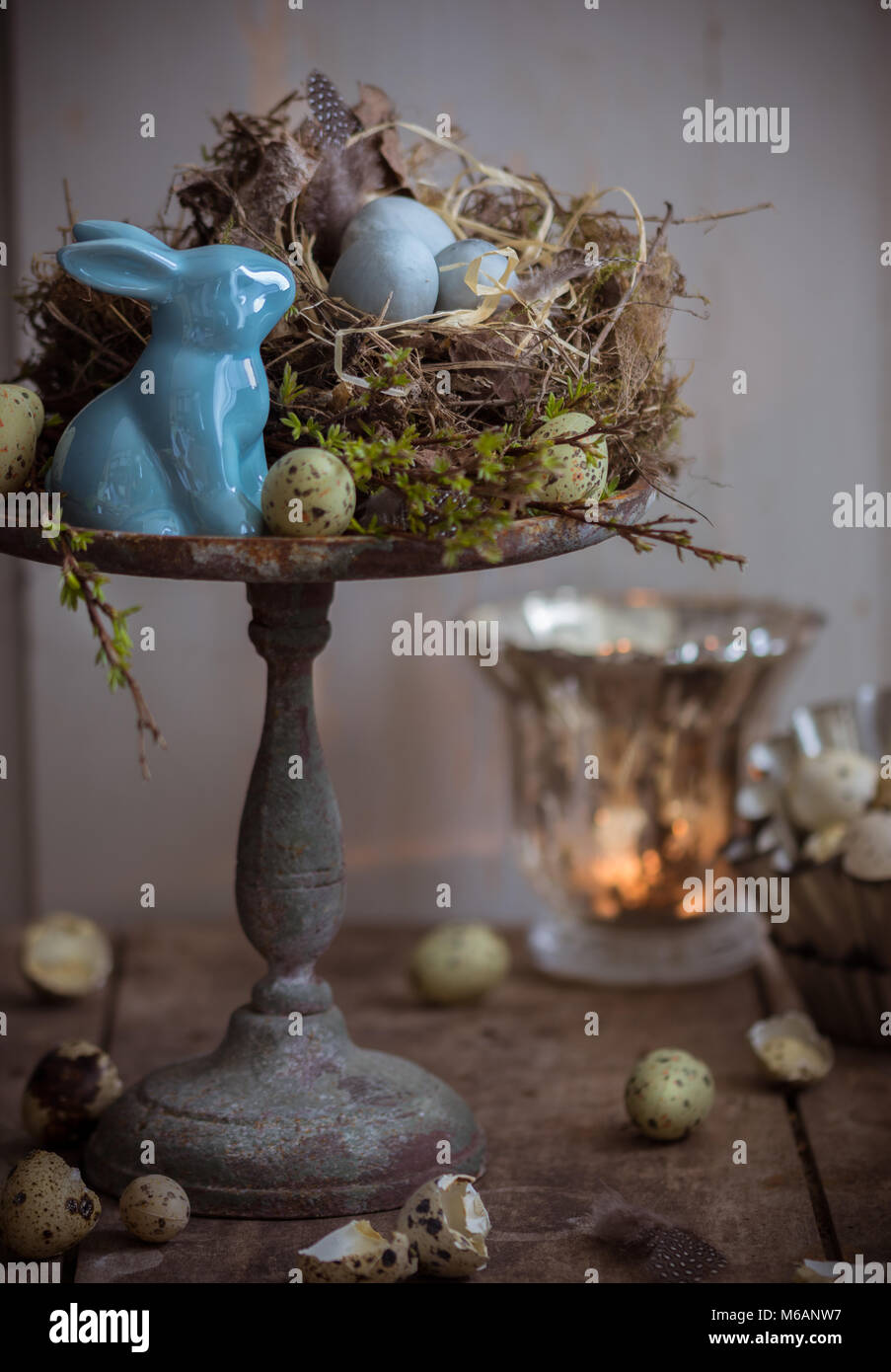 Easter table decoration in blue witch candlelight - Stock Image