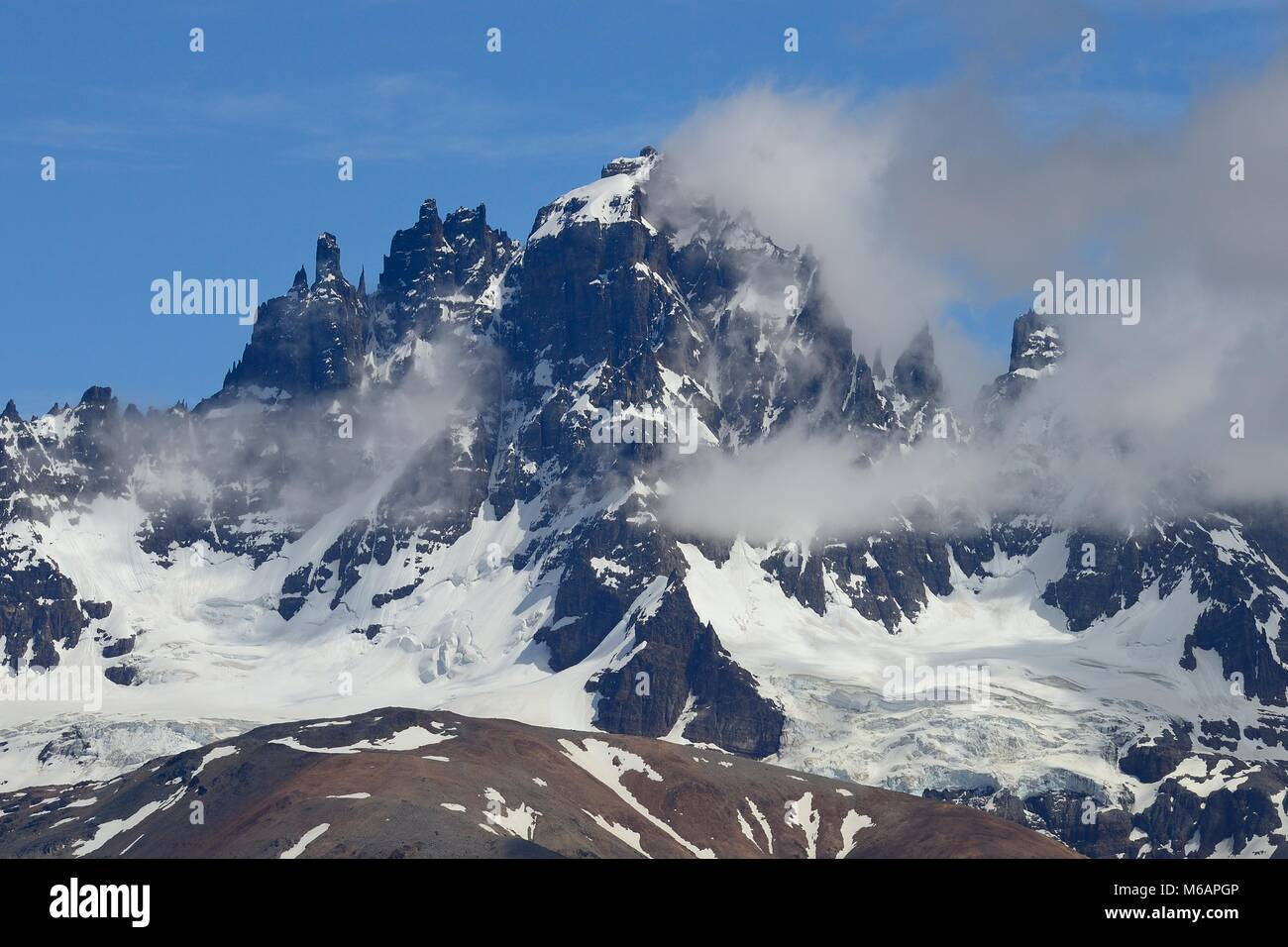 Cerro Castillo with clouds, Carretera Austral, near Villa Cerra Castillo, Región de Aisén, Chile - Stock Image