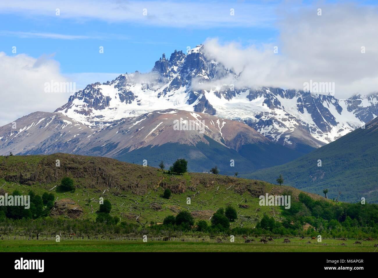 Cerro Castillo with clouds, Carretera Austral, near Villa Cerra Castillo, XI., Región de Aisén, Chile - Stock Image