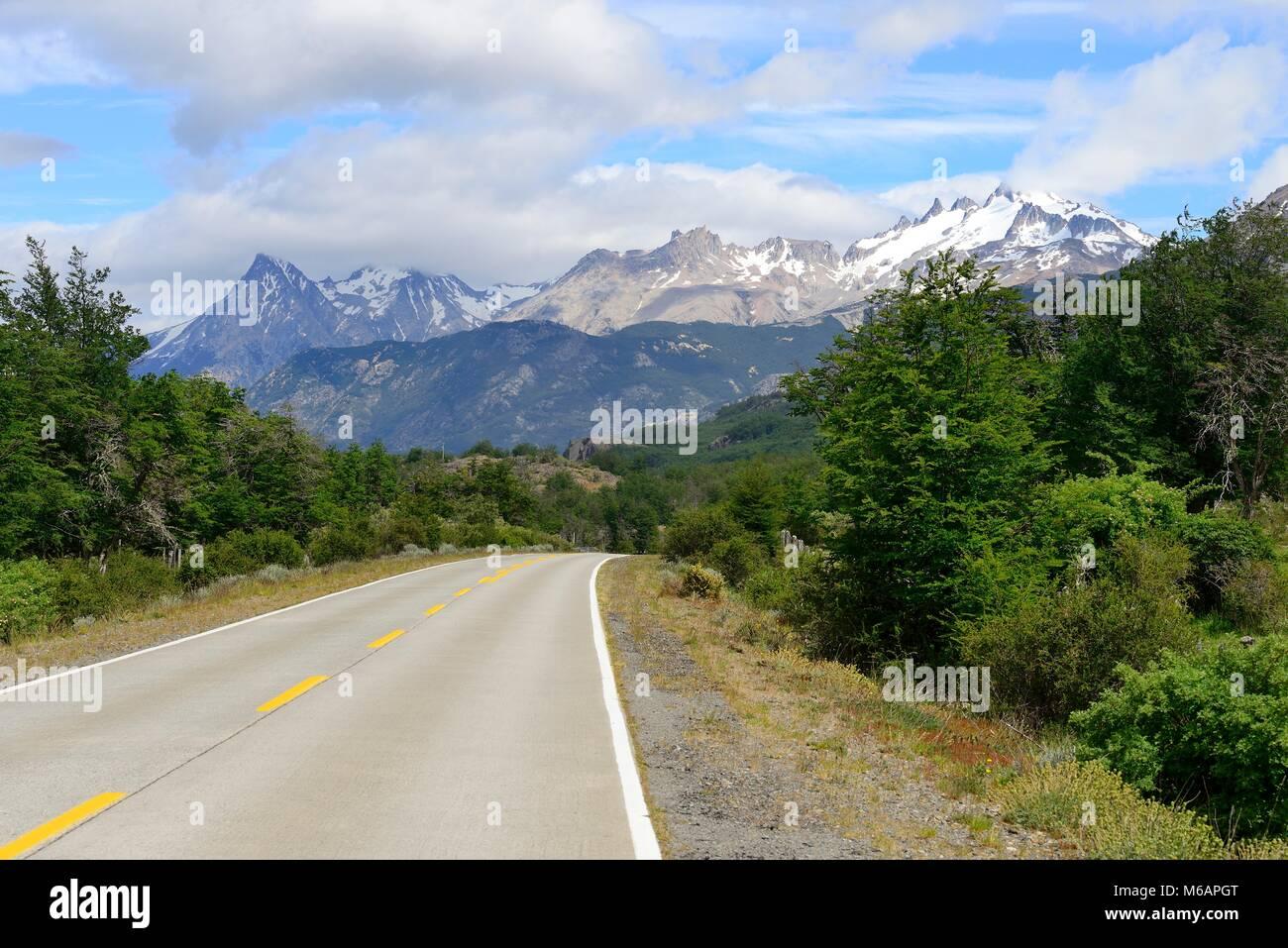 Asphalted section of the Carretera Austral, Cerro Castillo in the background, Reserva National Cerro Castillo - Stock Image