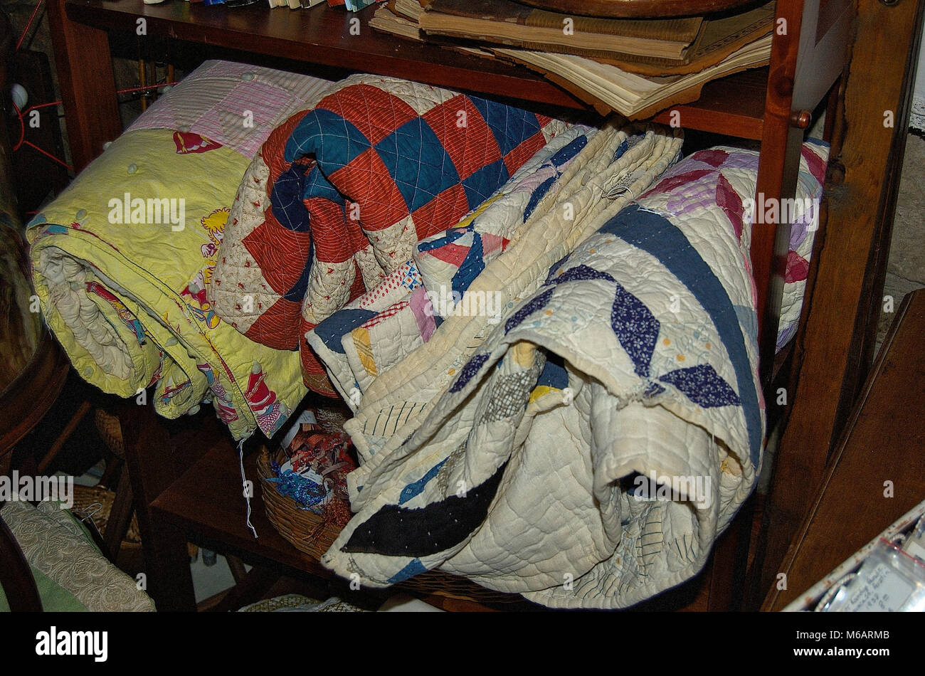Antique vintage blankets stored on shelf Stock Photo