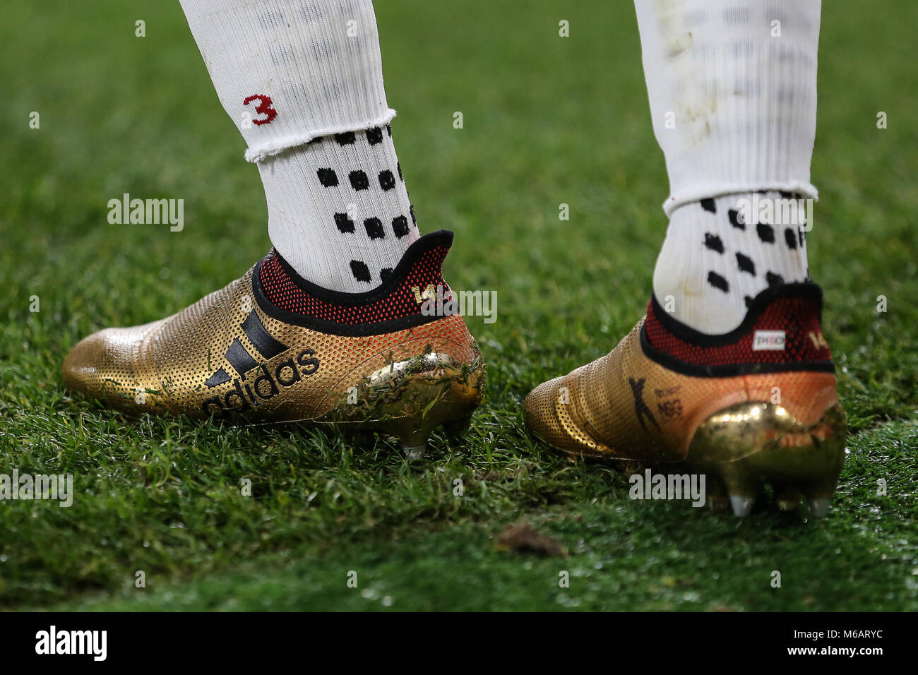Adidas boots and socks of Theo Walcott of Arsenal during the UEFA Europa League match between Arsenal and FC BATE - Stock Image