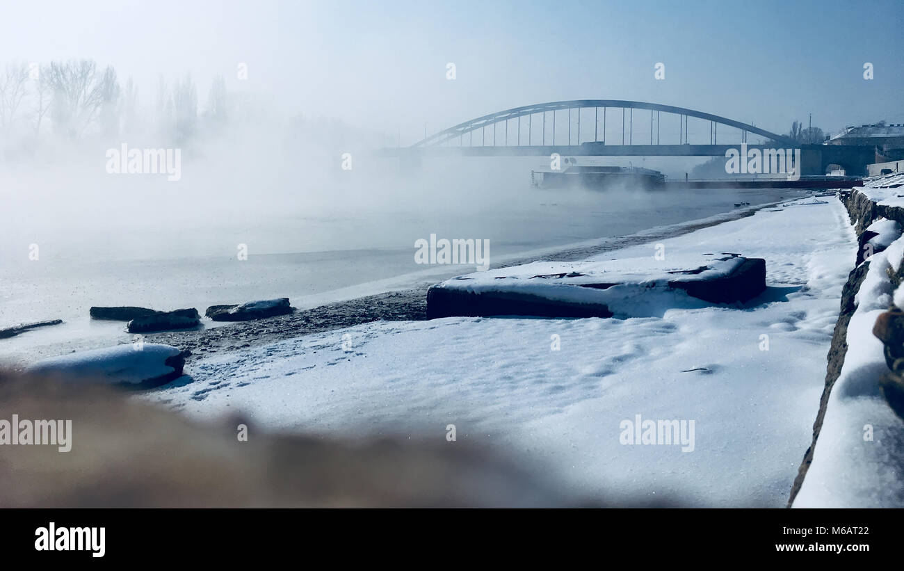 Landscape of frozen Tisza river in winter environment in Europe, Hungary, Szeged. - Stock Image