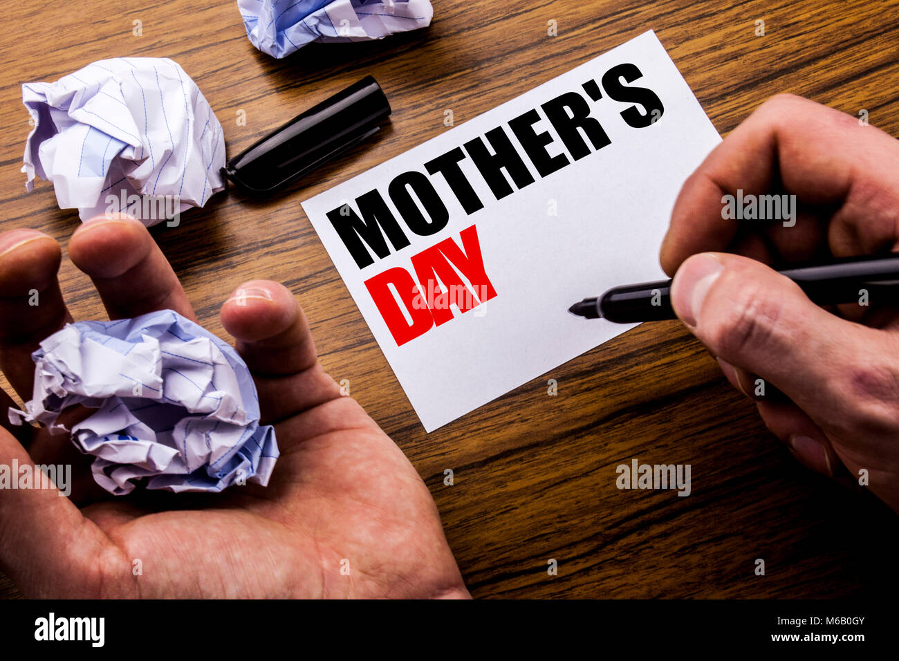 Handwriting text mother day concept for mom greetings celebration handwriting text mother day concept for mom greetings celebration written on notebook note paper on wooden background with folded paper meaning thi m4hsunfo