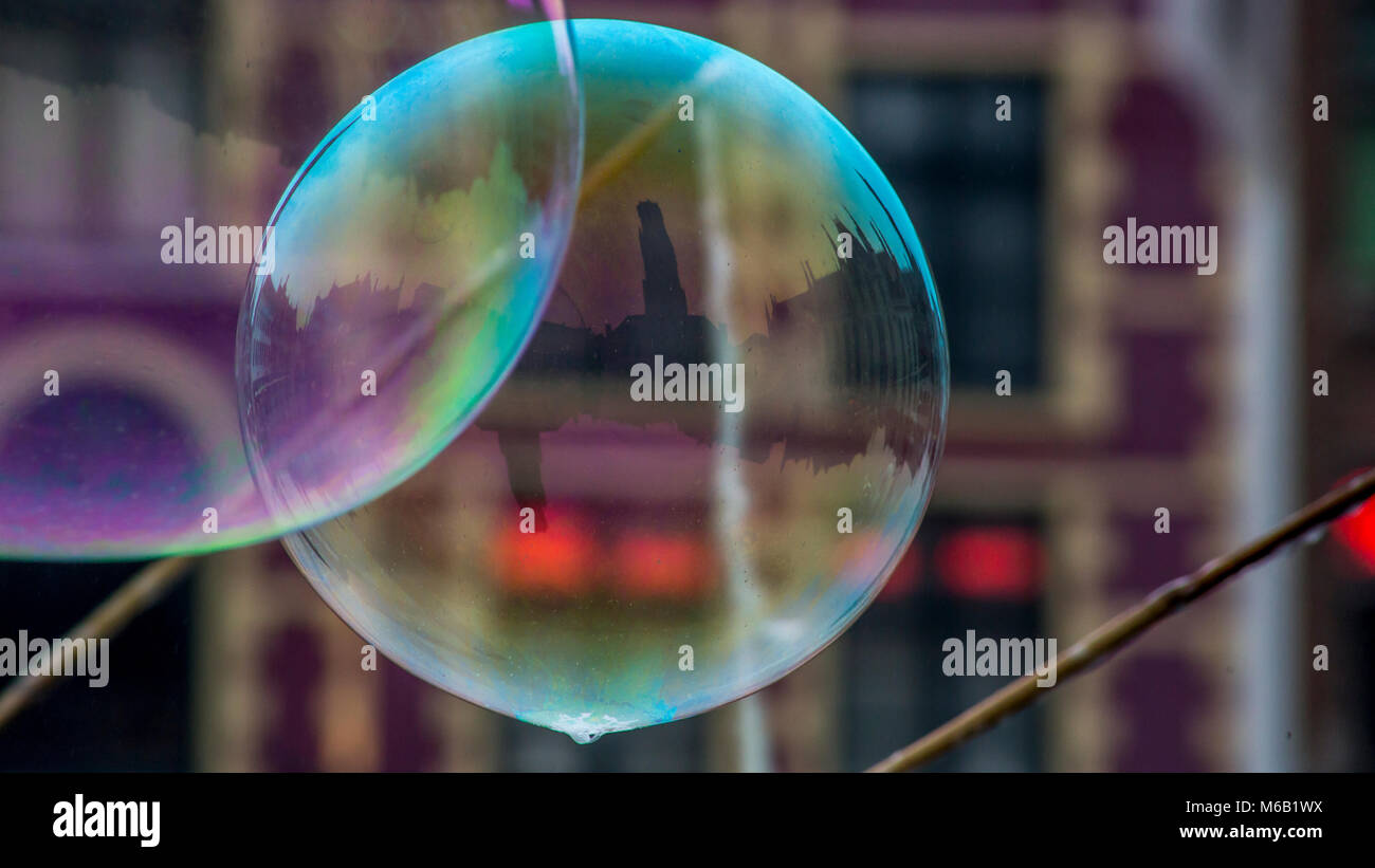 Bubbles blown in the Market Square in Bruges reflect the surrounding ancient medieval buildings including the tallest Stock Photo