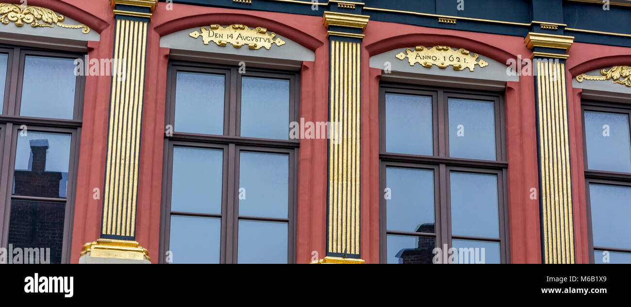 Gold painted pilasters giving the appearance of supporting columns is a fine example of an architectural element - Stock Image