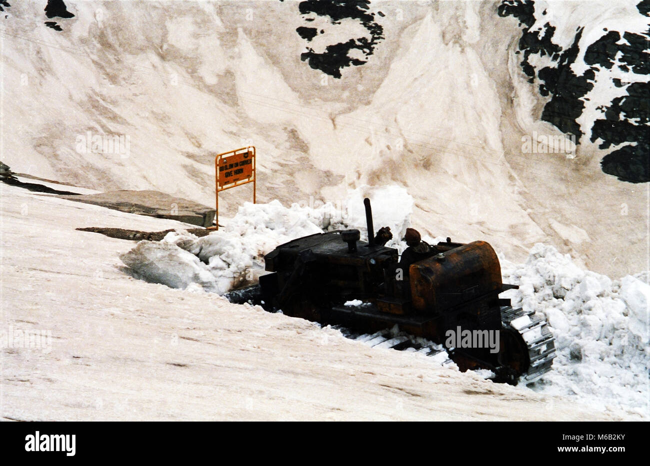 Clearing the Rohtang Pass on the Himalayan road connecting The Kulu valley and Lahaul and Spiti in  Himachal Pradesh. - Stock Image