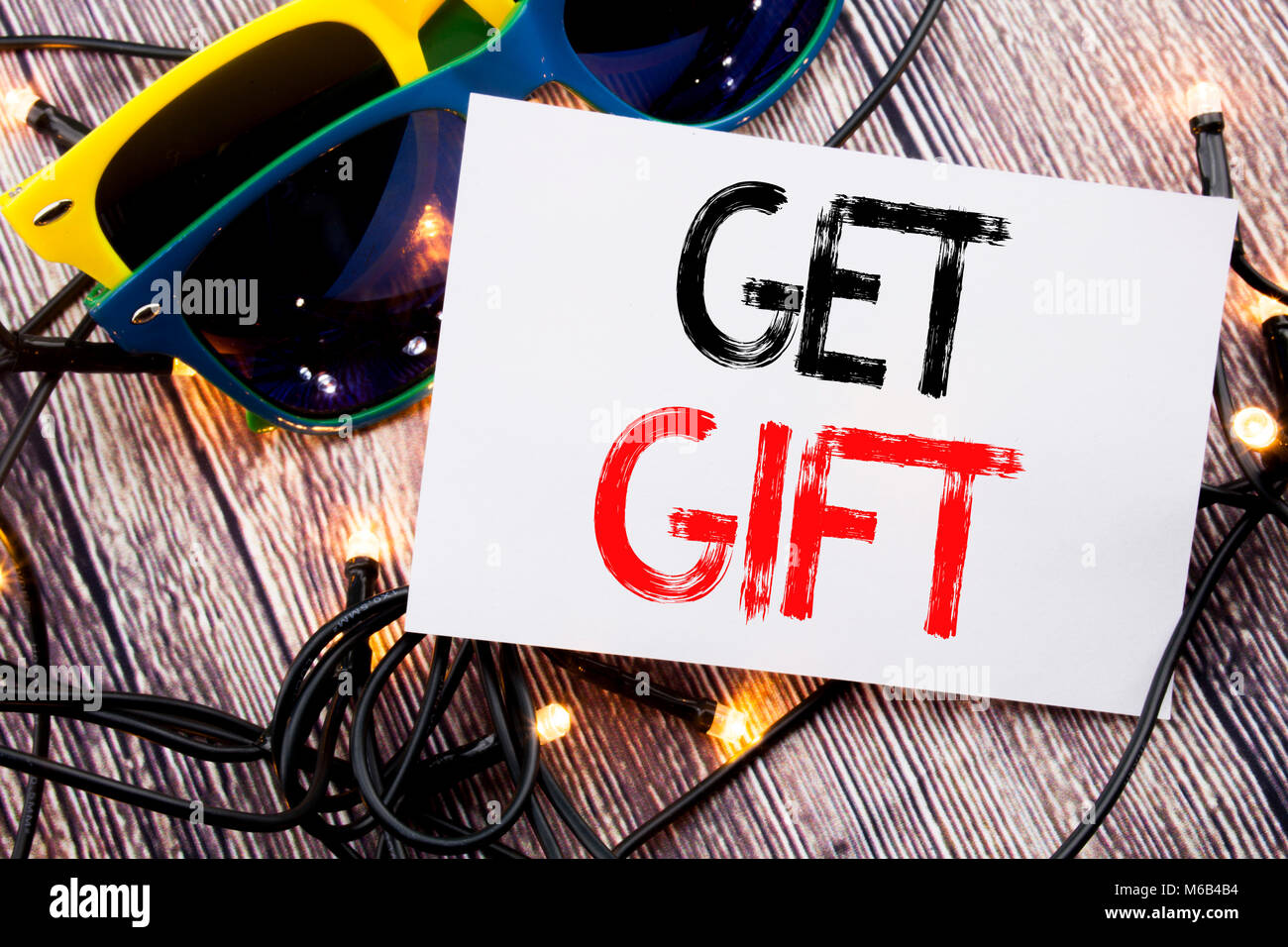 Writing text showing Get Gift. Business concept for Free Shoping Coupon written on old wood wooden background with - Stock Image