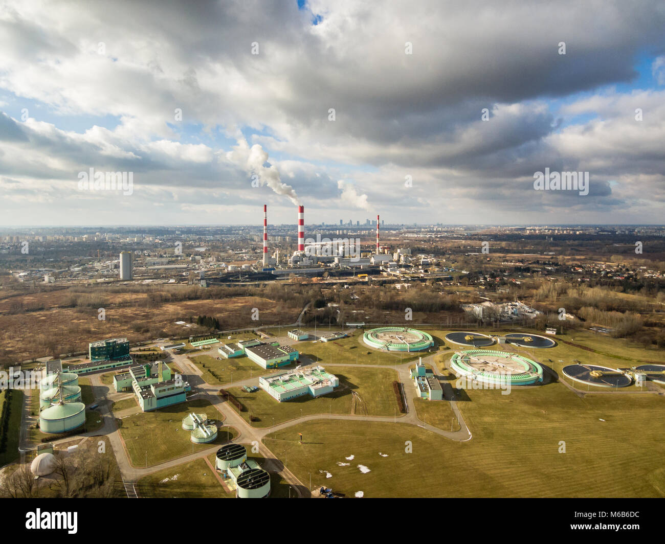 Aerial view of power plant and sewage treatment plant under cloudy sky, Warsaw - Stock Image
