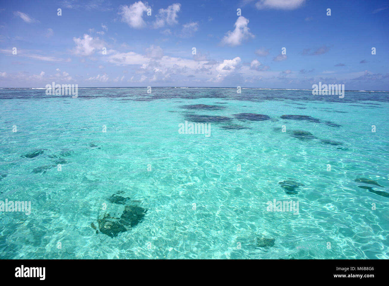 Tropical caribbean sea, clear turquoise water & beautiful blue sky, Montego Bay, Jamaica. - Stock Image