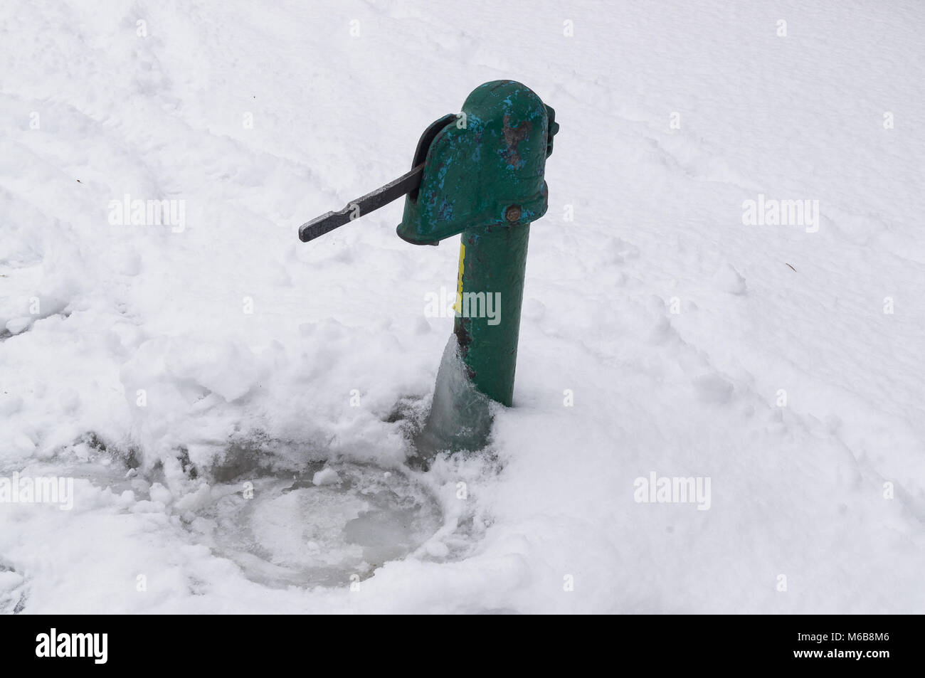Frozen water faucet for public use. In winter, a pipe froze on the street. Problems with water, because it stops - Stock Image
