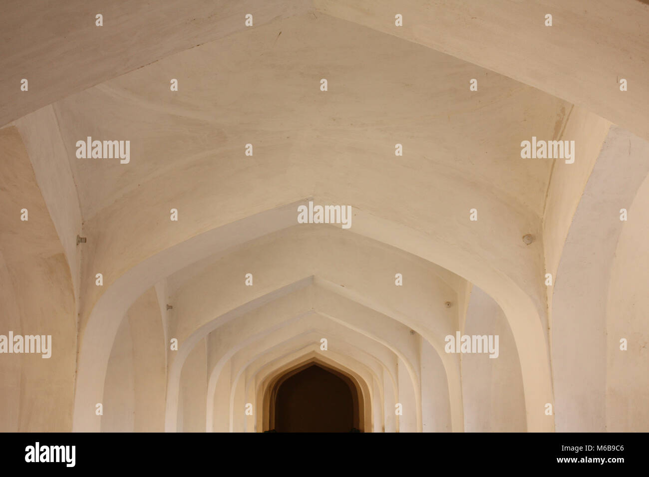 Geometric hallway in natural colors and central perspective. Takes in Rajastan, India. - Stock Image