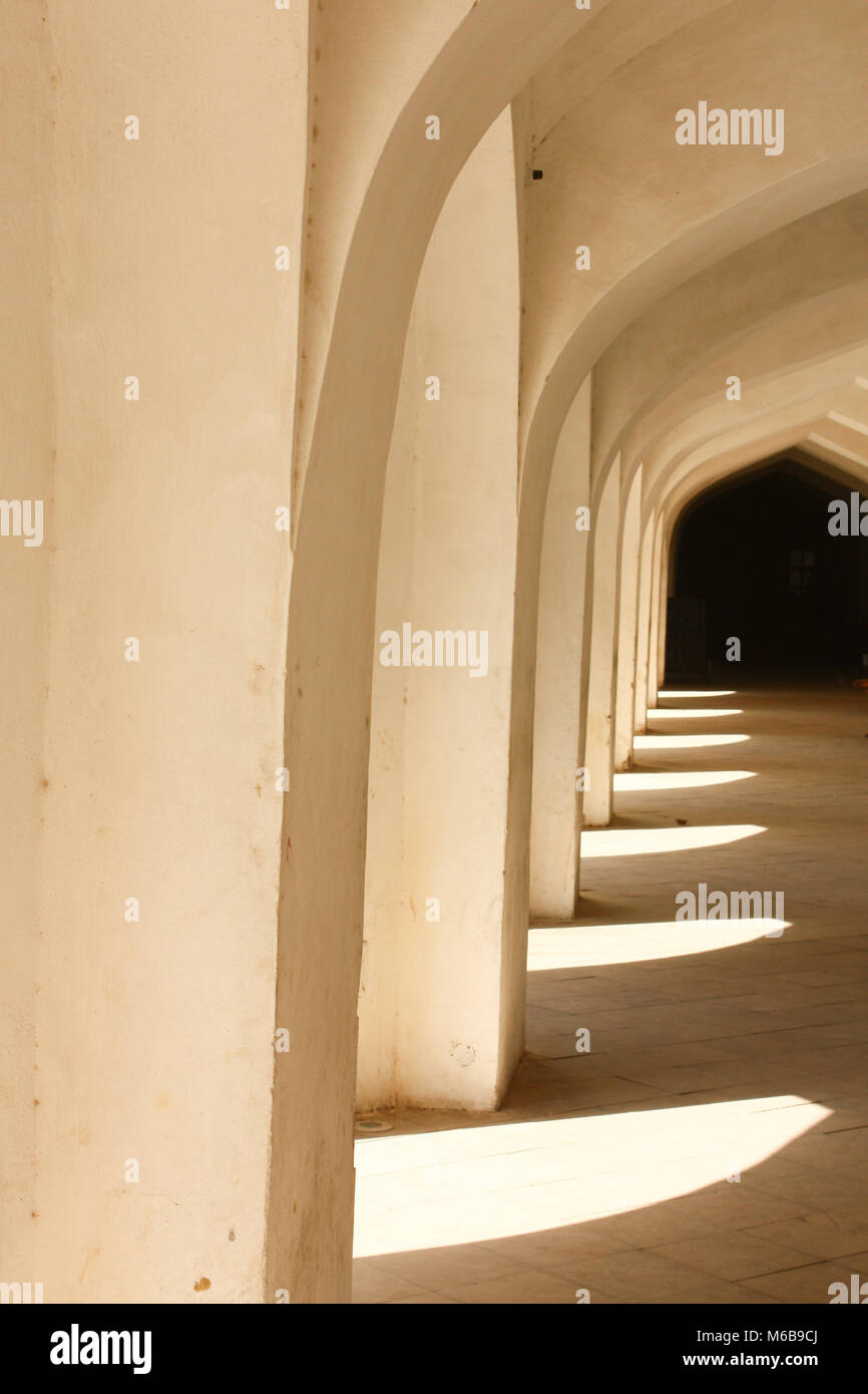 Geometric hallway in natural colors and central perspective. Taken in Rajastan, India. - Stock Image