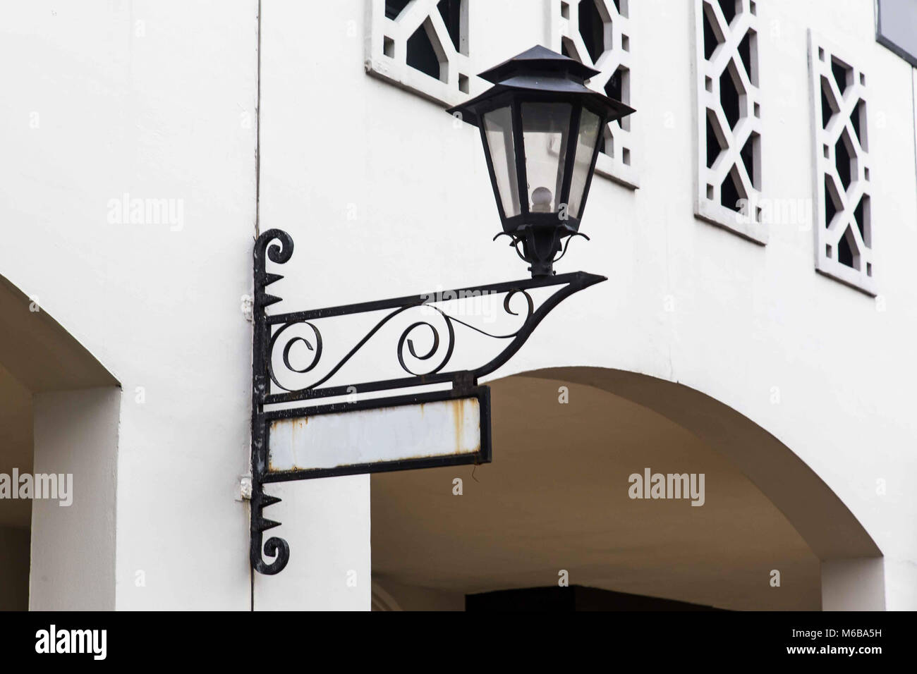 Old lamp and street sign - Stock Image
