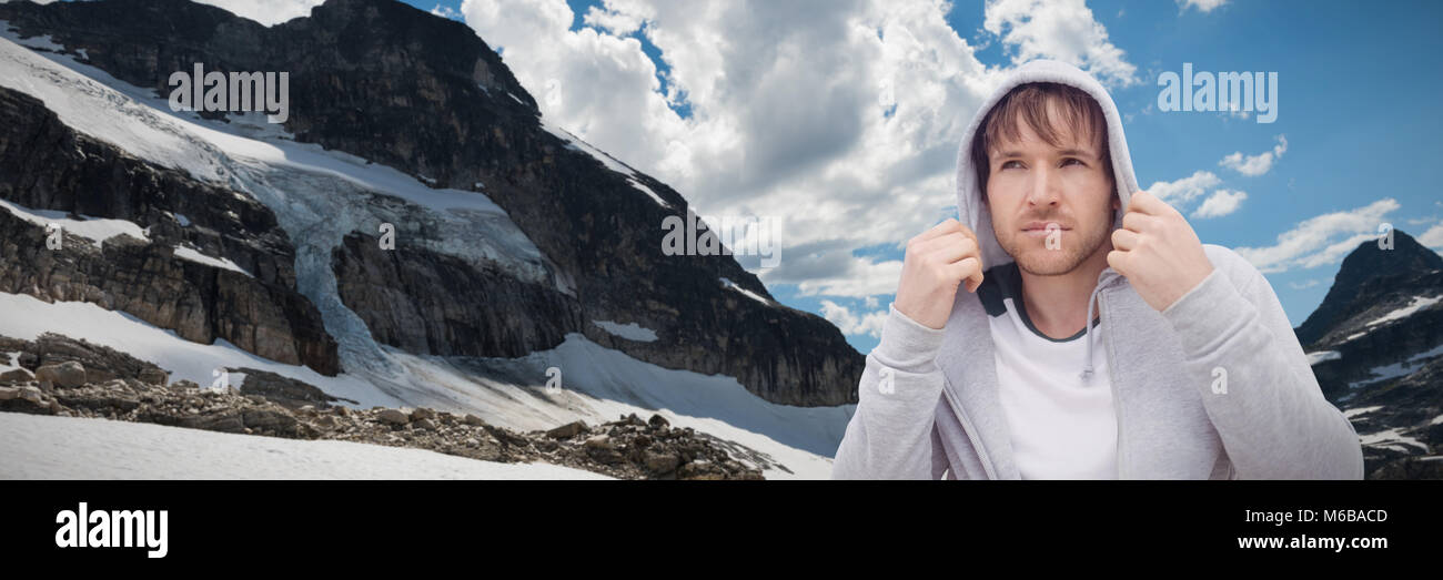 Composite image of portrait confident, cool young latino man wearing hoody - Stock Image
