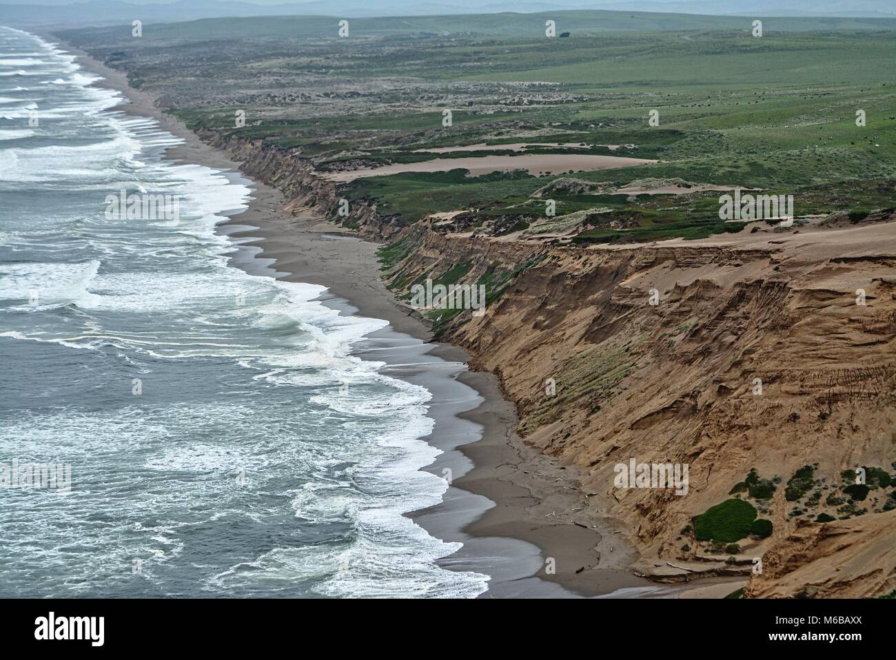 Point Reyes national seashore - rainy day and rough sea at Invernesse seahore - long sandy california coast - Stock Image