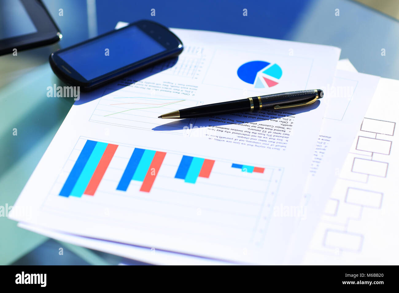 Financial charts on the table - Stock Image