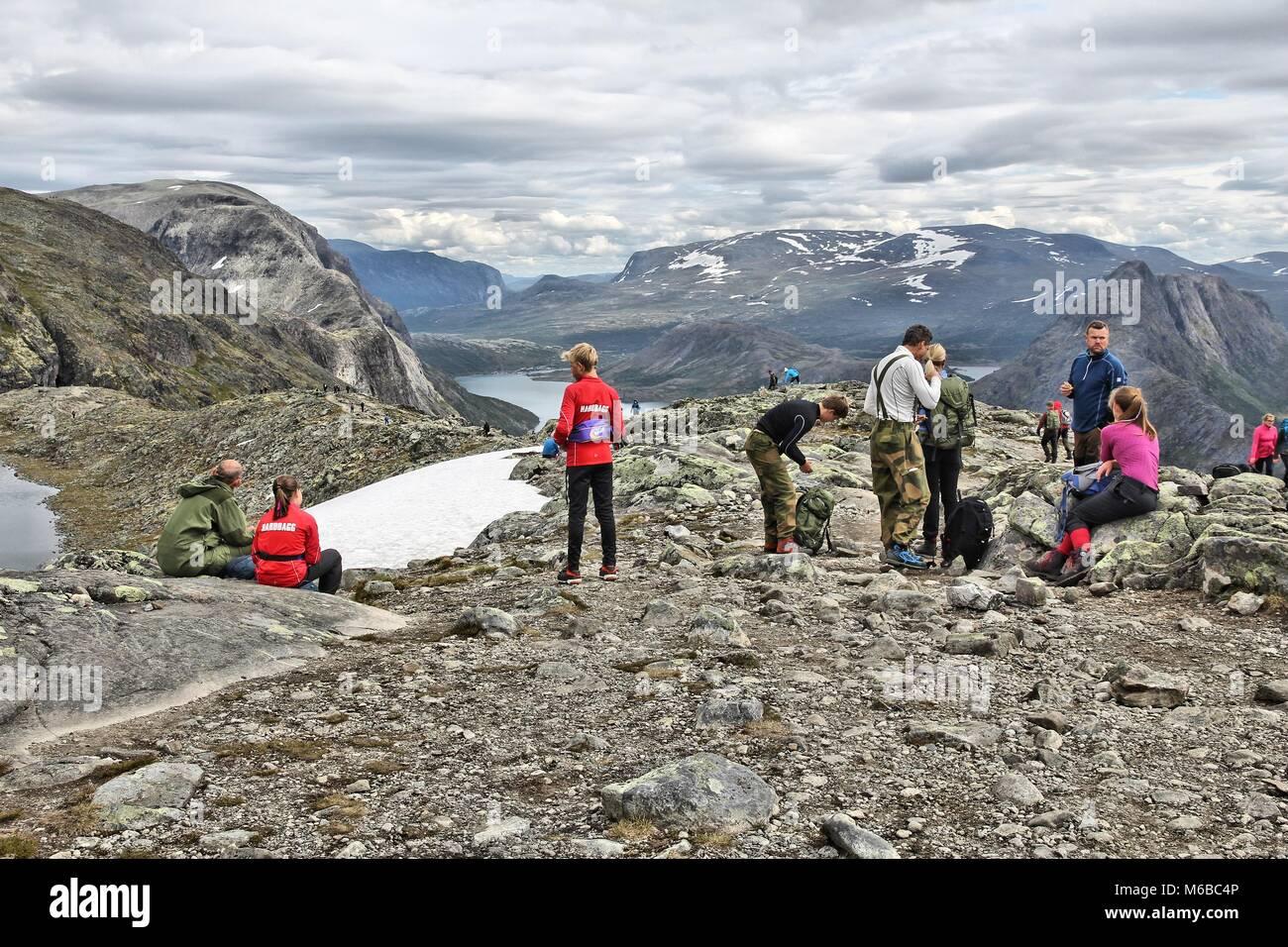 JOTUNHEIMEN, NORWAY - AUGUST 1, 2015: People rest at Besseggen trail in Jotunheimen National Park, Norway. Norway - Stock Image