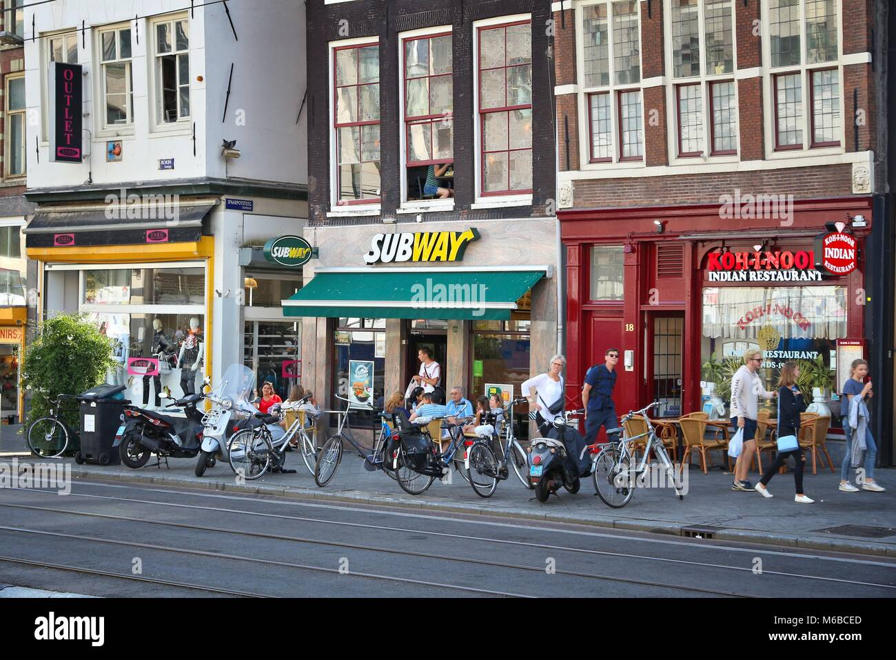 AMSTERDAM, NETHERLANDS - JULY 9, 2017: People shop at Rokin street in Amsterdam. Amsterdam is the capital city of - Stock Image