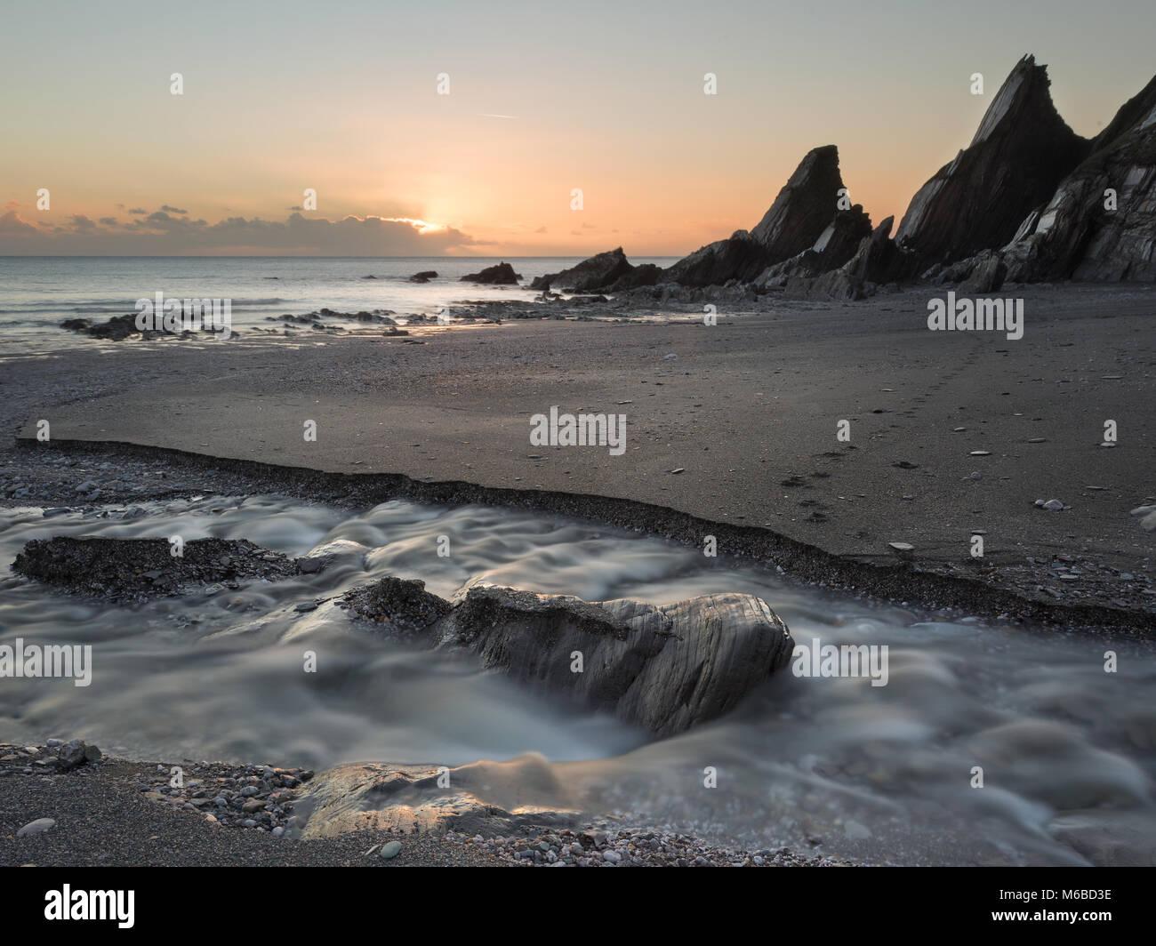 Westcombe Beach at sunset South Hams - Stock Image