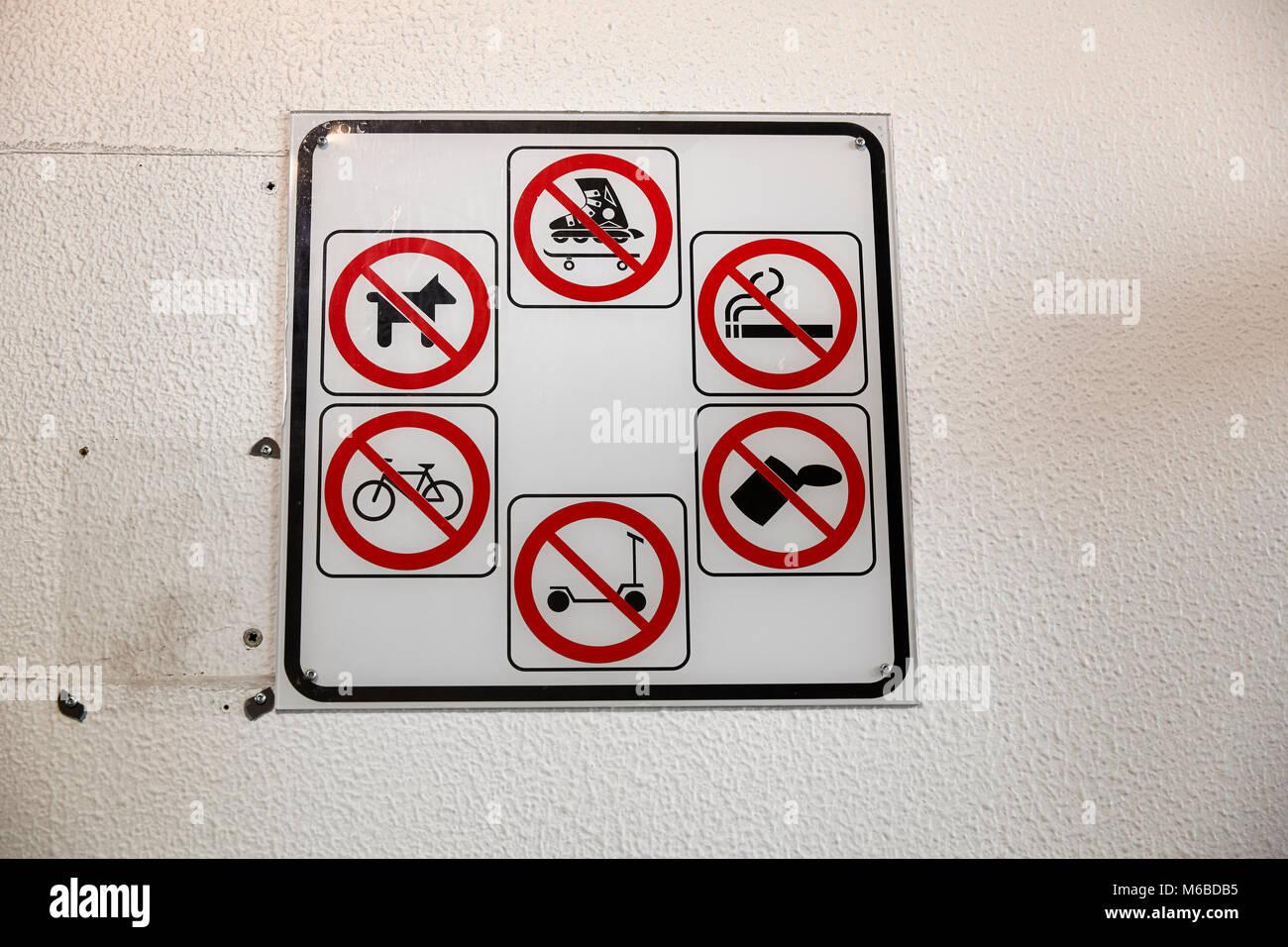 No dogs, no skating, no smoking, no littering, no scooter, no bicycles signs - Stock Image