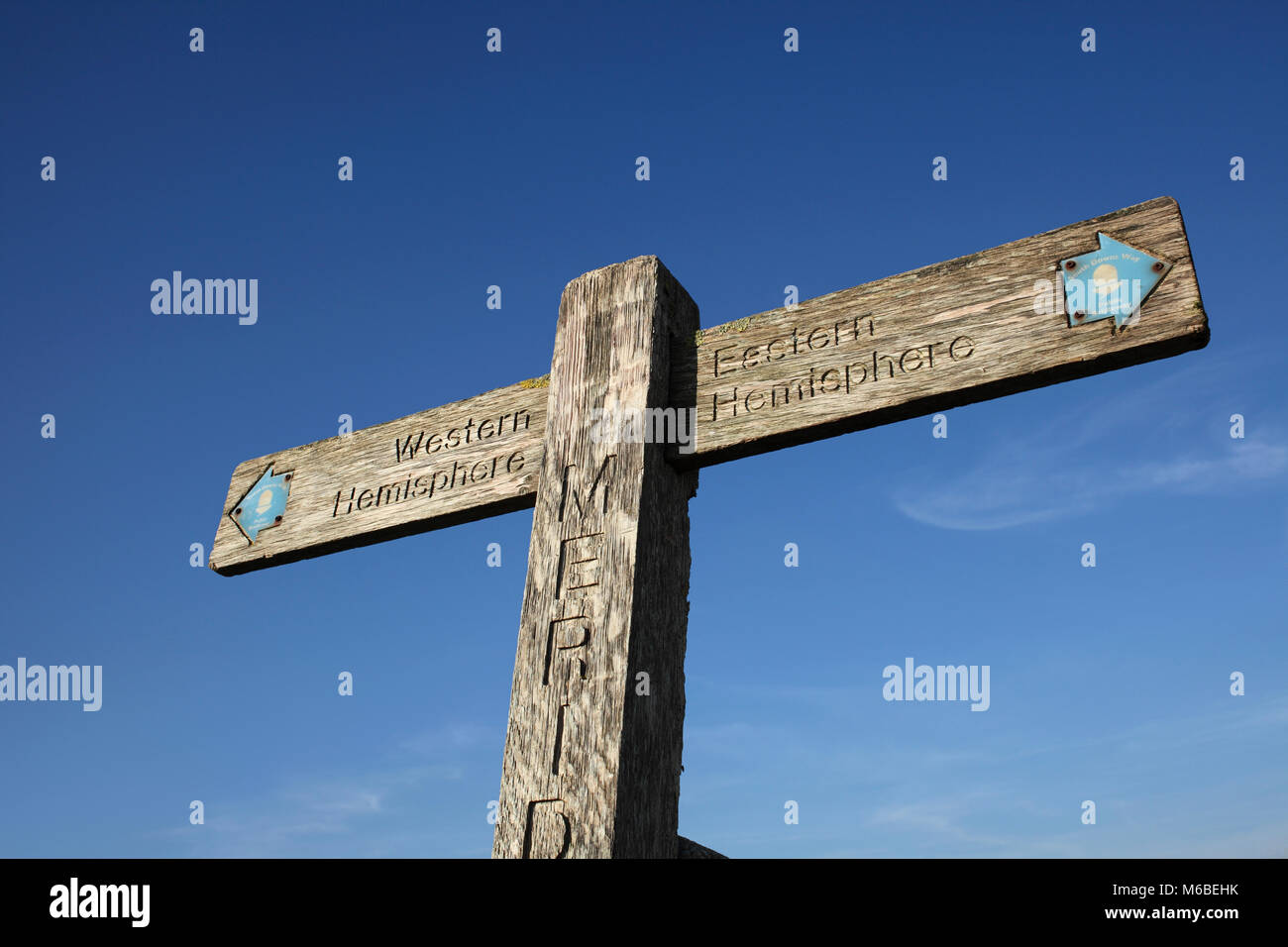 A wooden signpost on the South Downs marking the Greenwich Meridian. It points left to the 'Western Hemisphere' - Stock Image
